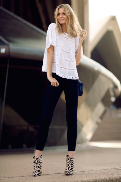 white peasant top with black cropped slim jeans and boots