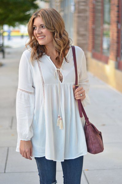 white long peasant top with blue skinny jeans