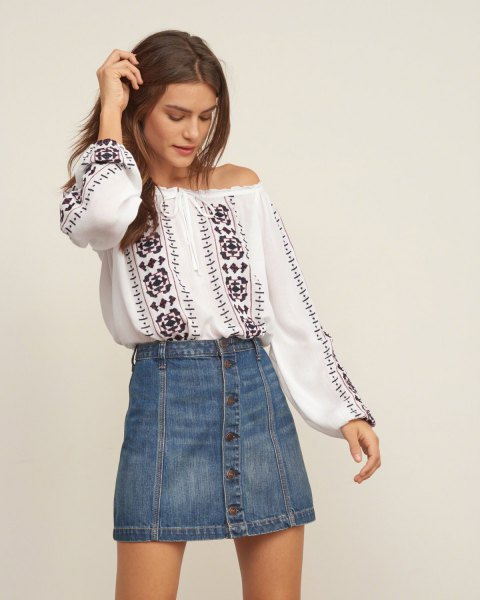white from shoulder-padded top blue denim button in front of mini skirt
