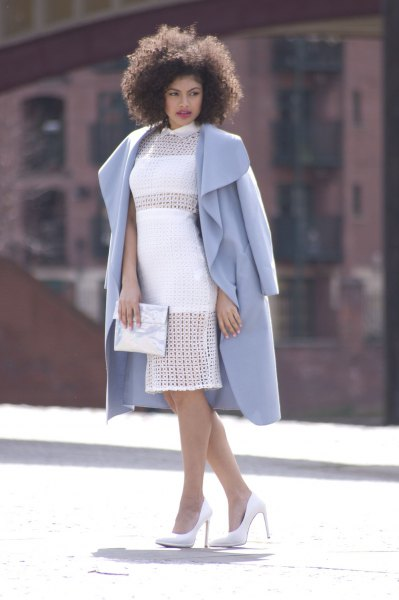 sky blue long wool coat white midi dress silver clutch bag