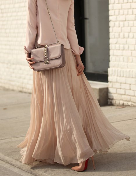 pink and silver shoulder bag with reddish maxi skirt