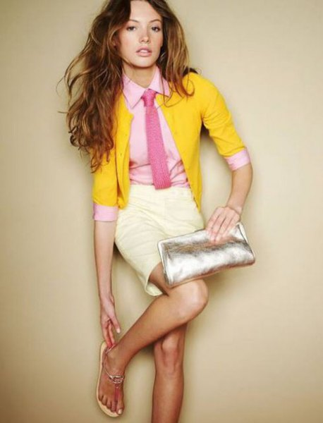 silver evening bag yellow cardigan pencil skirt
