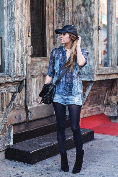 gray chambray shirt blue denim shorts black leather baseball cap
