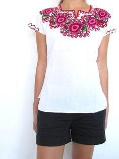 white mexican farmer blouse black shorts