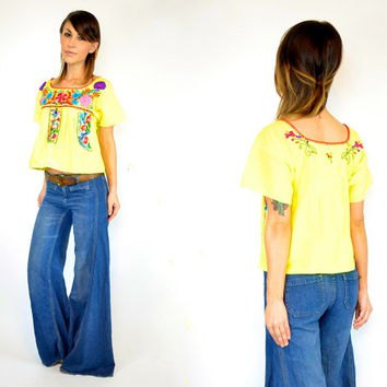 yellow mexican farmer blouse blue puffed jeans