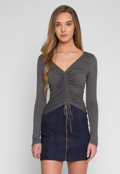 gray v-neck ruched long sleeve top dark blue mini skirt