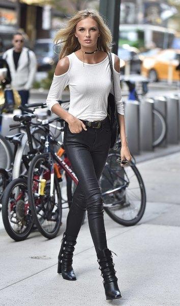 white long sleeve cold shoulder strap black leather pants