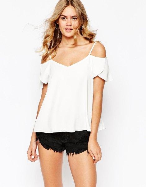 white cold shoulder top black mini fringe denim shorts