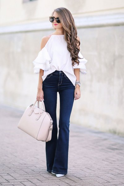 white halter neck cold shoulder sweater with puffed jeans
