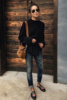 black sweater in cuff in cuffed skinny jeans with embroidered loafers