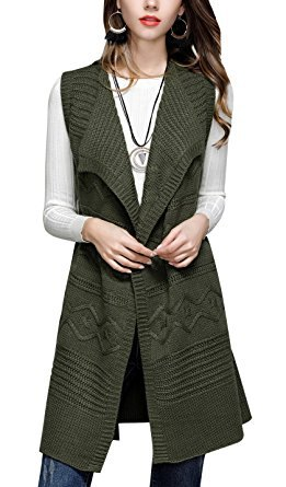 green long cable knit sweater vest over white ribbed top