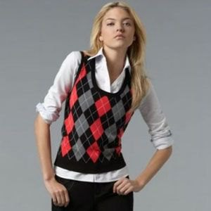red gray black patterned sweater vest white shirt jeans