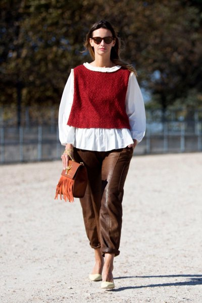 green sweater vest white blouse brown leather pants