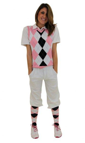 white polo shirt knee length golf shorts