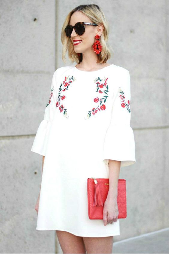 white embroidered dress red details