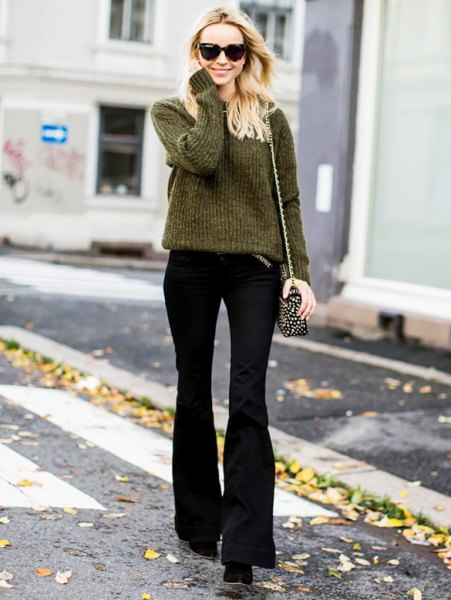 green rib knit sweater with black flared trousers