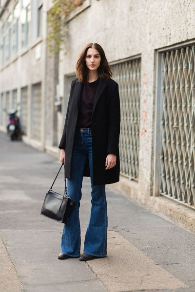 blue puffed jeans with black long wool coat