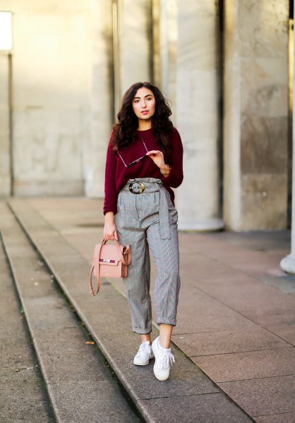 dark green sweater with high height cuffed plaid trousers