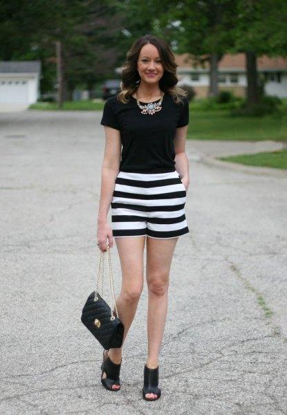 black t-shirt striped shorts statement necklace