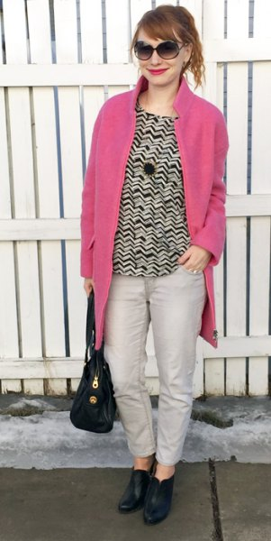 neon pink coat black and white patterned sweater