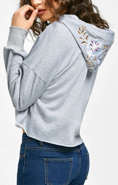 gray floral embroidered hoodies blue skinny jeans
