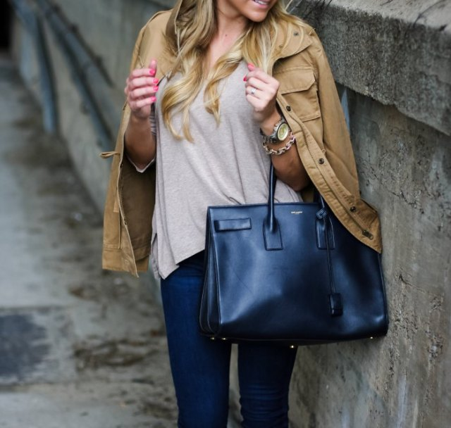 light brown jacket gray tee dark blue skinny jeans