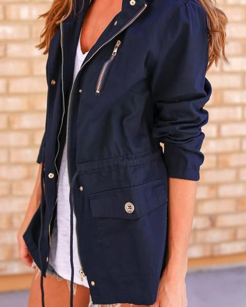 black anorak jacket white v-neck vest in denim shorts