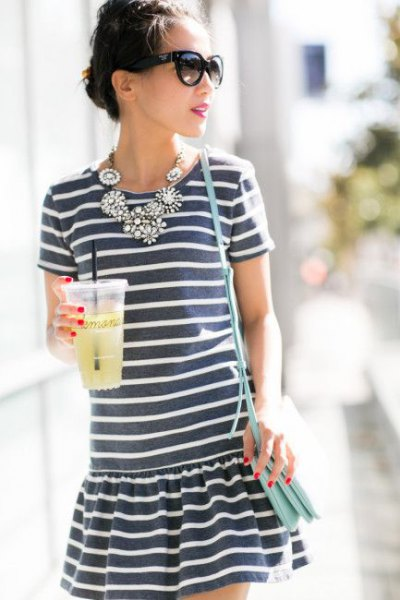 gray and white striped mini dress with statement necklace