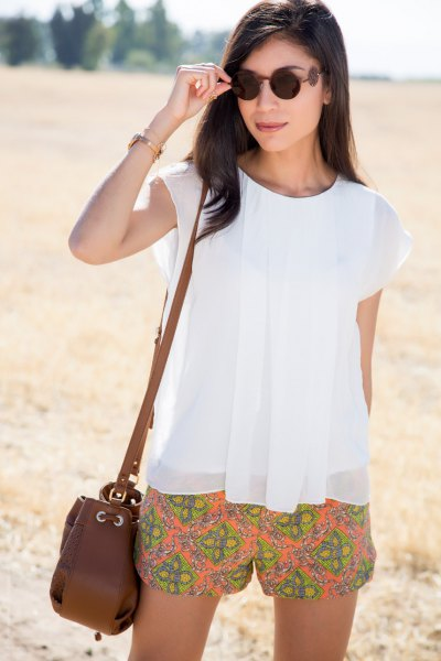 white chiffon cap sleeve top orange printed floating shorts