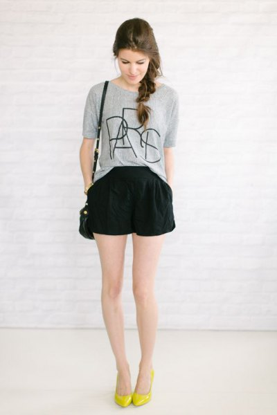 gray printed t-shirt black flowing shorts