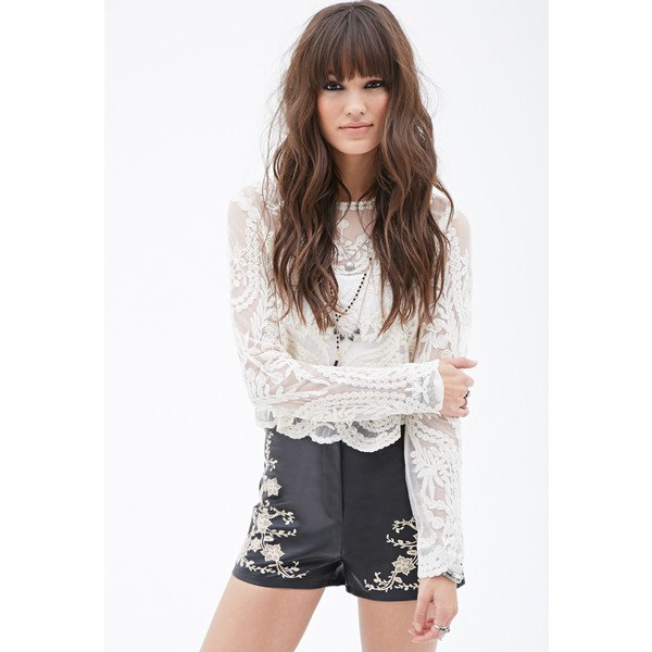 white long sleeve lace top with black leather embroidered shorts