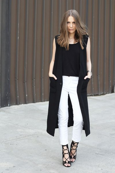 black long sleeveless vest white skinny jeans