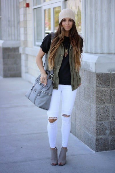 black t-shirt ripped white skinny jeans