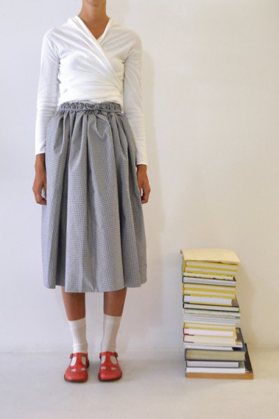white jacket cardigan gray pleated mini skirt