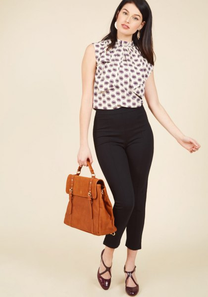 black and white printed sleeveless blouse with pants