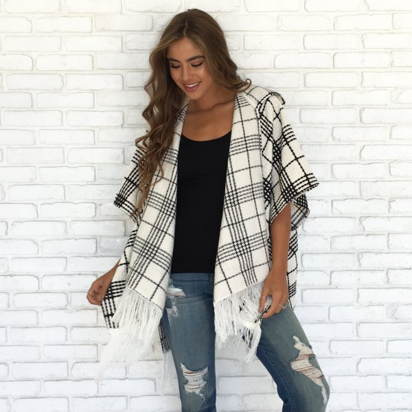 black vest top ripped gray jeans