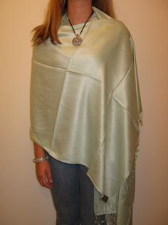 silver shawl white vest top blue skinny jeans