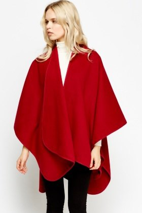 red fleece poncho with white sweater with hollow neck