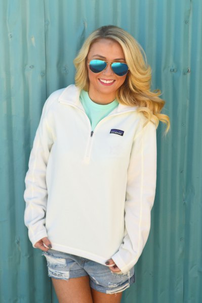white quarter zipper pull over blue denim shorts