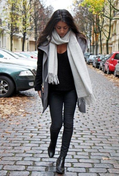 white cashmere scarf black sweater gray vest