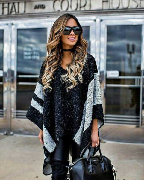 black knitted poncho with wide wide stripes