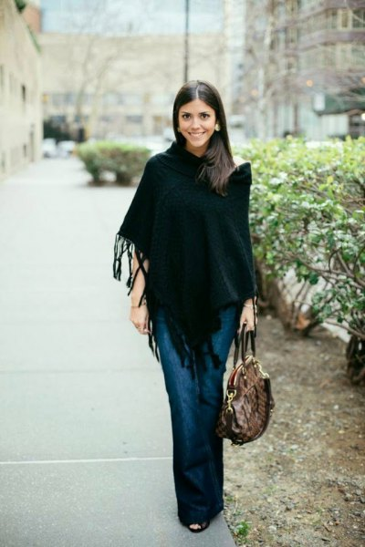 fringed poncho dark blue puffed jeans