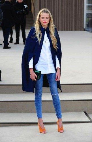 navy cape coat white button up shirt blue jeans