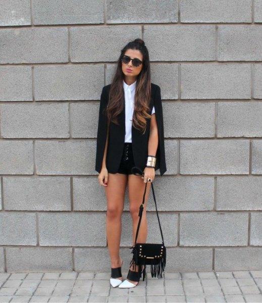 cape coat white shirt black denim shorts