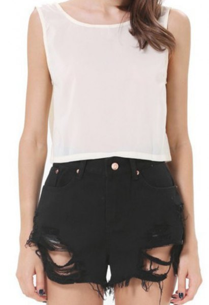 white chiffon sleeveless top black ripped shorts