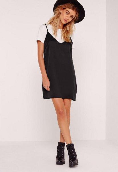 black mini cami dress over white t-shirt
