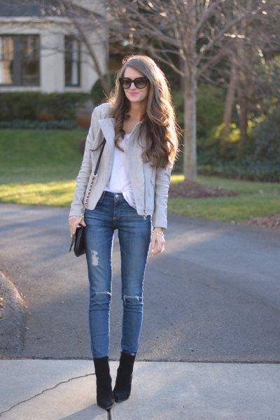 light gray leather jacket blue skinny jeans