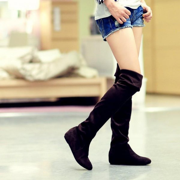 black knee high crease over boots denim shorts