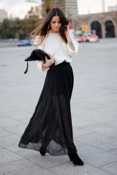 white sweater with wide sleeve, black clean skirt