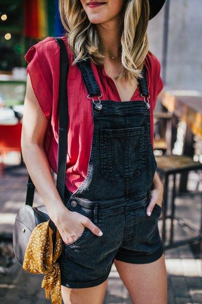 red cap sleeveless black denim overall shorts